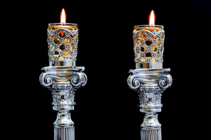 Shabbat candles. Silver candlesticks with olive oil